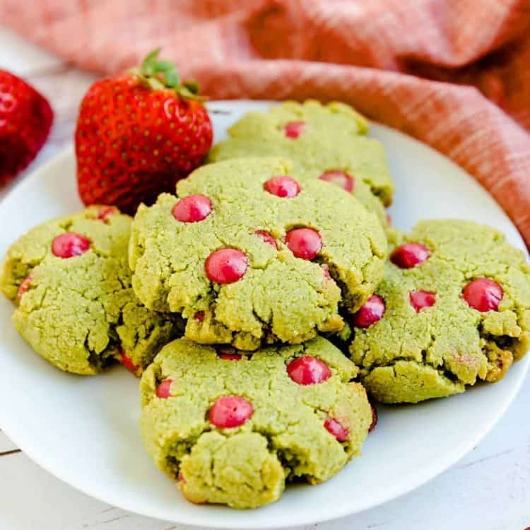 Keto Matcha Strawberry Cream Cheese Cookies served on a plate with fresh strawberries