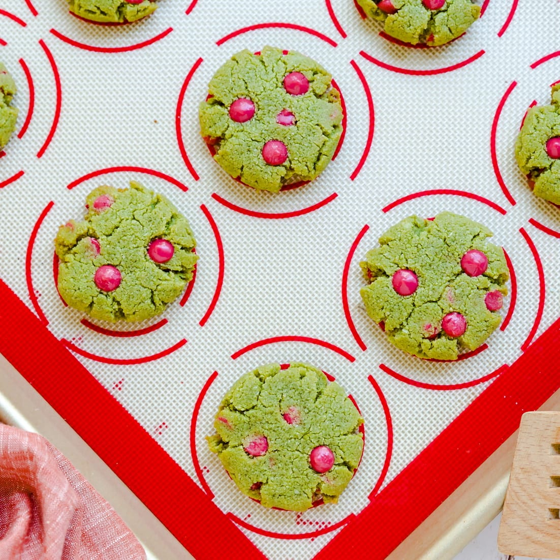 Keto matcha strawberry cream cheese cookies being cooled off after baking