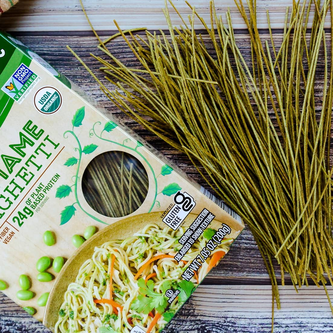 Box of edamame noodles next to unpackaged edmame noodles