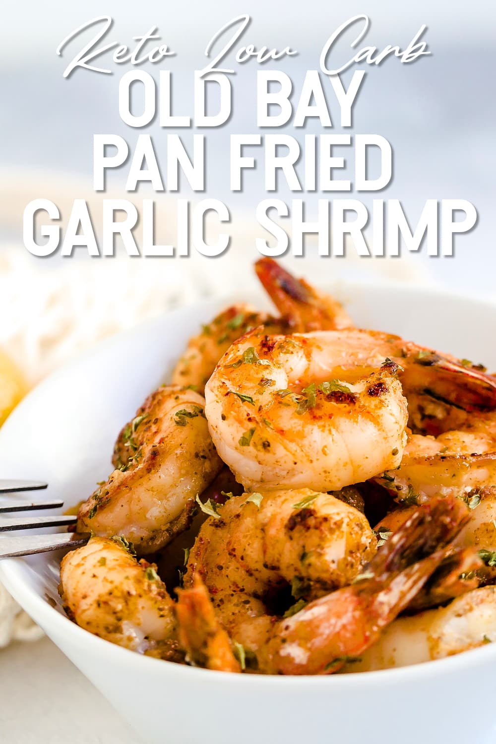 Old Bay Pan Fried Garlic Shrimp being picked up by a fork