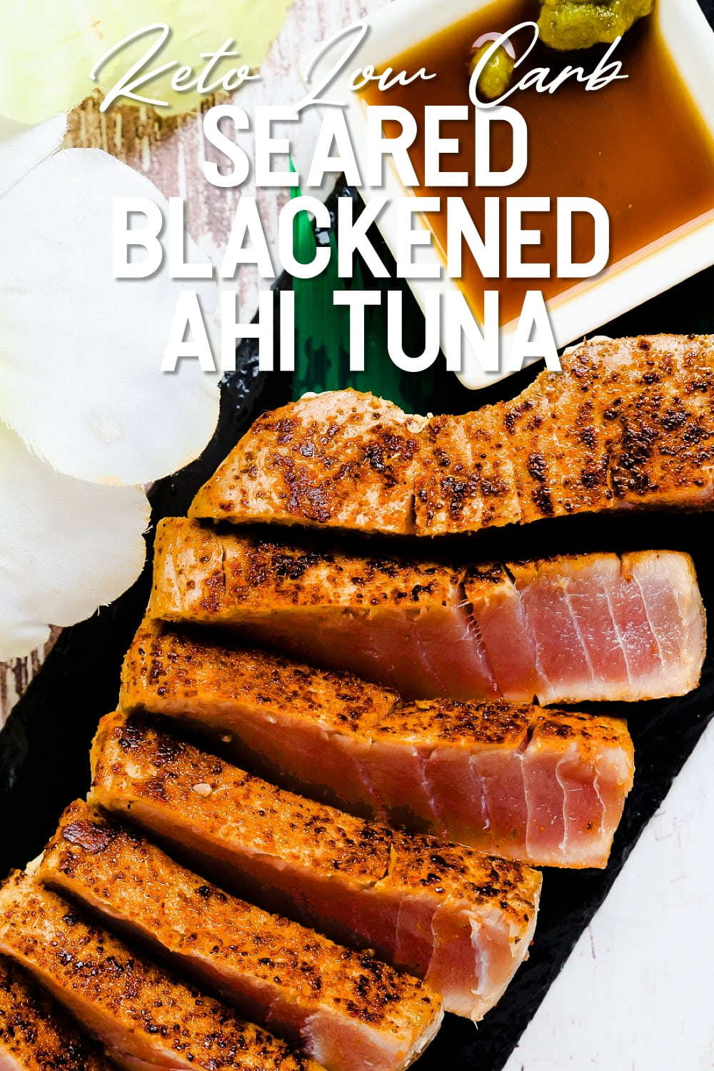 Seared Blackened Ahi Tuna Steak served on a black slate with dipping sauce