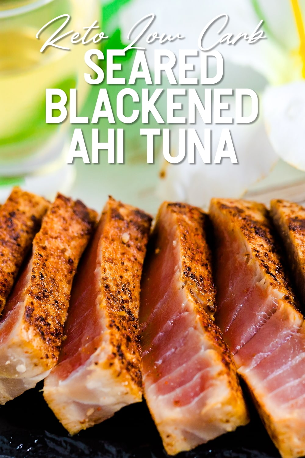 Seared Blackened Ahi Tuna Steak served on a black slate showing cross sectional cut