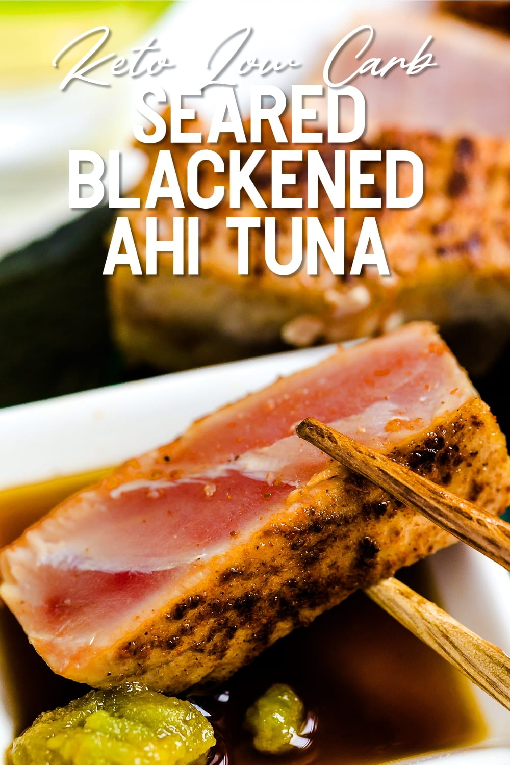 Seared Blackened Ahi Tuna Steak being dipping into a sweer wasabi umami soy sauce