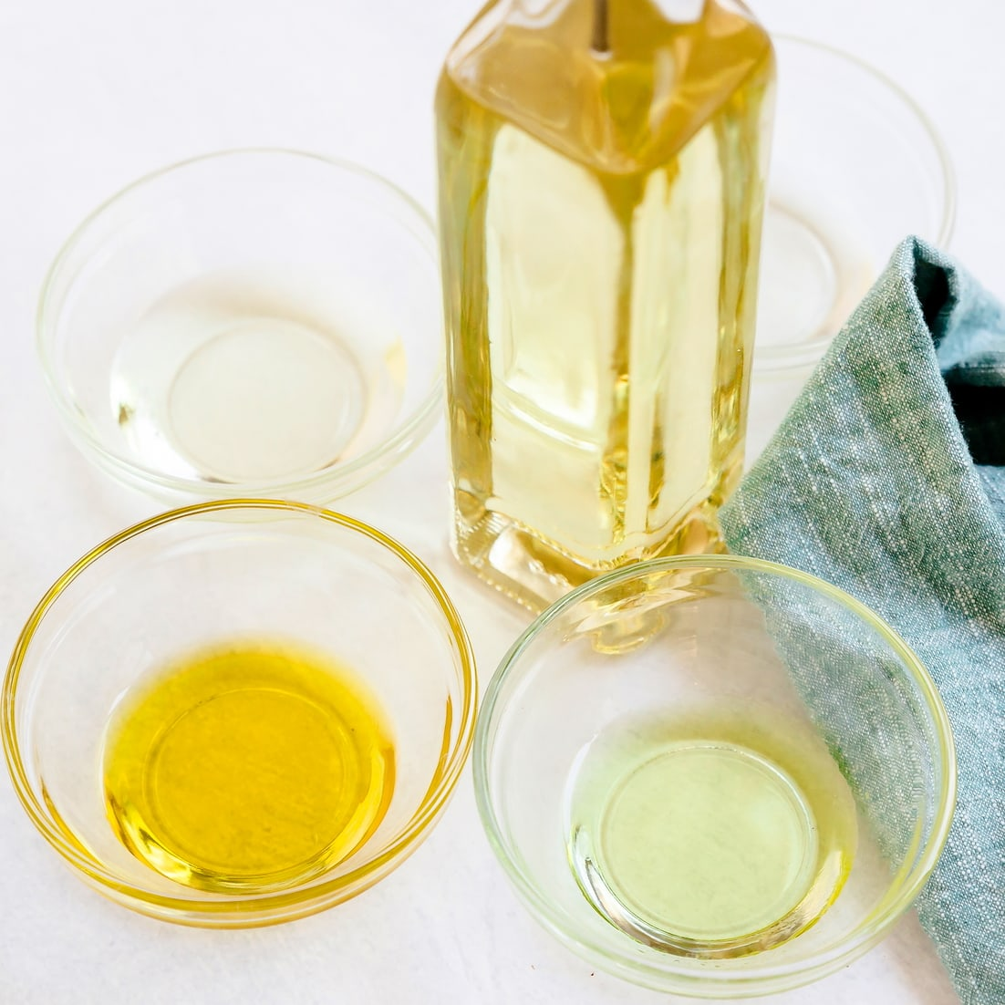 Sunflower oil, olive oil, canola oil and grapeseed oil poured into different bowls