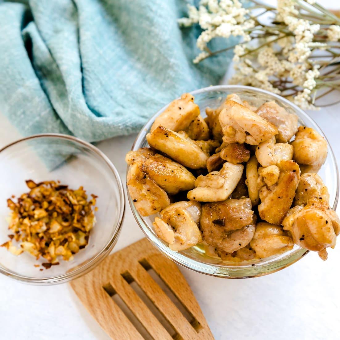 Minced crispy garlic next to cook spicy chicken