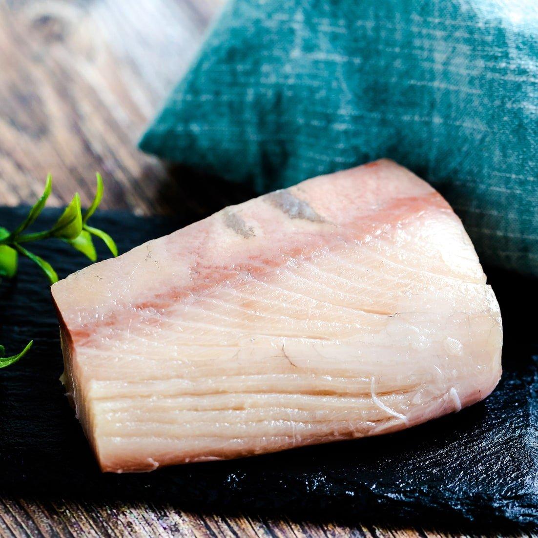 Block of Japanese yellowtail hamachi fish
